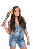 Woman holding big wrench Stock Images