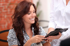Woman holding the bill Royalty Free Stock Photo