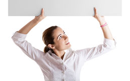Woman holding a billboard royalty free stock photo