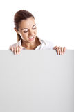 Woman holding a billboard Royalty Free Stock Photography