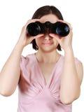 Woman holding binoculars Stock Image