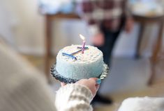 Woman holding birthday cake with number 1 and candle Stock Image