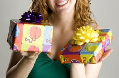 Woman holding birthday gifts Stock Photo
