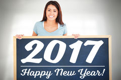 Woman holding a black board with new year text Royalty Free Stock Photography