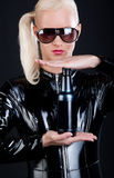 Woman holding a black bottle Royalty Free Stock Photo