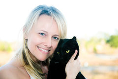 Woman Holding Black Cat Stock Photography