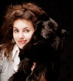 Woman holding black dog Royalty Free Stock Photography