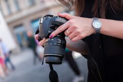 Woman Holding Black Dslr Camera Royalty Free Stock Photo