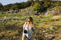 Woman Holding Black Dslr Camera Near Forest Stock Image
