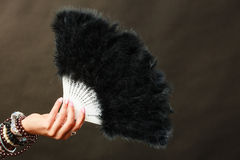 Woman holding black feather fan in hand Stock Photos