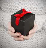 Woman holding black gift box Royalty Free Stock Photos