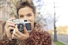 Woman Holding Black and Gray Camera Focus Photo royalty free stock photo