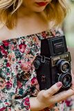 Woman Holding Black Nomo Vintage Camera royalty free stock photography