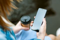 Woman Holding Black Smartphone With Black Screen stock photos