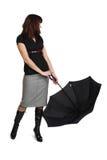 Woman is holding black umbrella. Stock Image