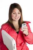Woman holding a Blackberry and laptop Stock Image
