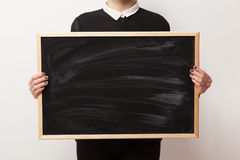 Woman holding a blackboard Royalty Free Stock Photography