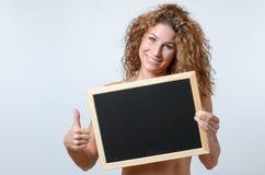Woman Holding blackboard Royalty Free Stock Photography