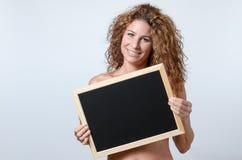 Woman Holding blackboard Royalty Free Stock Photo