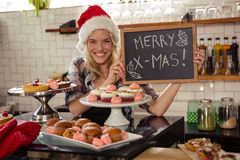 Woman holding blackboard with merry christmas Stock Photography