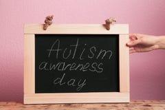 Woman holding blackboard with phrase Stock Photos