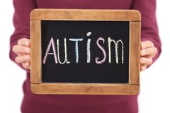 Woman holding blackboard with word. `AUTISM`, closeup Royalty Free Stock Images