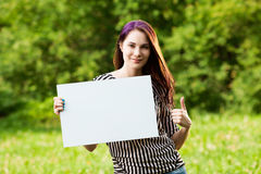 Woman holding blank banner Royalty Free Stock Photo