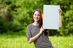 Woman holding blank banner Stock Photo