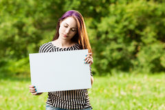 Woman holding blank banner Stock Images
