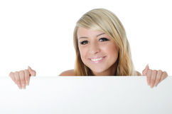 Woman holding a blank billboard Stock Photography