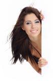 Woman holding a blank billboard. Beautiful smiling girl holding a blank billboard stock images