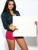 Woman holding a blank billboard Royalty Free Stock Photography