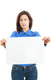 Woman holding a blank billboard isolated on white background Stock Images