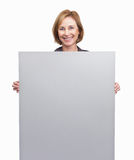 Woman holding blank billboard over white backgroun Stock Photography