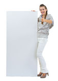 Woman holding blank billboard and showing thumb up Stock Photo