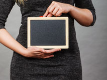 Woman holding blank black board on stomach. Tummy belly problems, pain, digestion, constipation concept. Woman holding blank black board on stomach Royalty Free Stock Photos