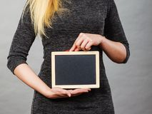 Woman holding blank black board on stomach. Tummy belly problems, pain, digestion, constipation concept. Woman holding blank black board on stomach Royalty Free Stock Photo