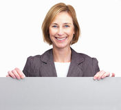 Woman holding blank board in front Stock Images