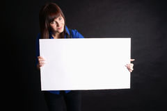 Woman Holding Blank Board On Black Background. Royalty Free Stock Photos