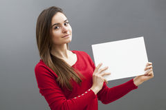 Woman holding blank board or paper for your advert Stock Images