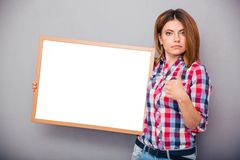 Woman holding blank board and showing thumb up Royalty Free Stock Photos