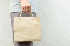 Free Woman Holding Blank Brown Paper Bag Package Stock Photo - 97648620