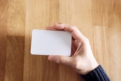 Woman holding blank business card Stock Photography