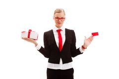Woman holding blank businesscard and giftbox. Blonde woman holding blank businesscard and giftbox over white background royalty free stock photos
