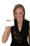 Woman Holding Blank Card 1. Attractive smiling business woman holding blank card with room for text royalty free stock photography