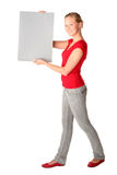 Woman Holding Blank Card. Woman holding blank poster board Royalty Free Stock Photos