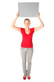 Woman Holding Blank Card. Woman holding blank poster board Royalty Free Stock Images