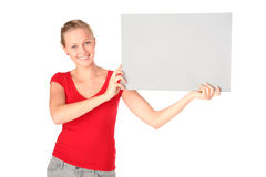 Woman Holding Blank Card. Woman holding blank poster board Royalty Free Stock Photo
