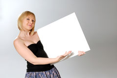 Woman holding blank card. Attractive blond woman holding blank card Royalty Free Stock Image