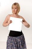 Woman holding blank card. Attractive blond woman holding blank card Stock Image